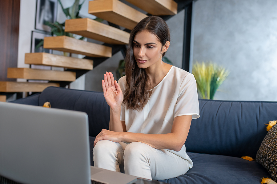 Woman talking to her therapist during their online therapy program